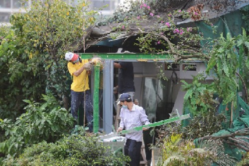 guangzhou illegal structure penthouse treehouse tianhe demolition extra stories