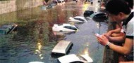 beijing flooding bridge underpass cars rain sewage infrastructure